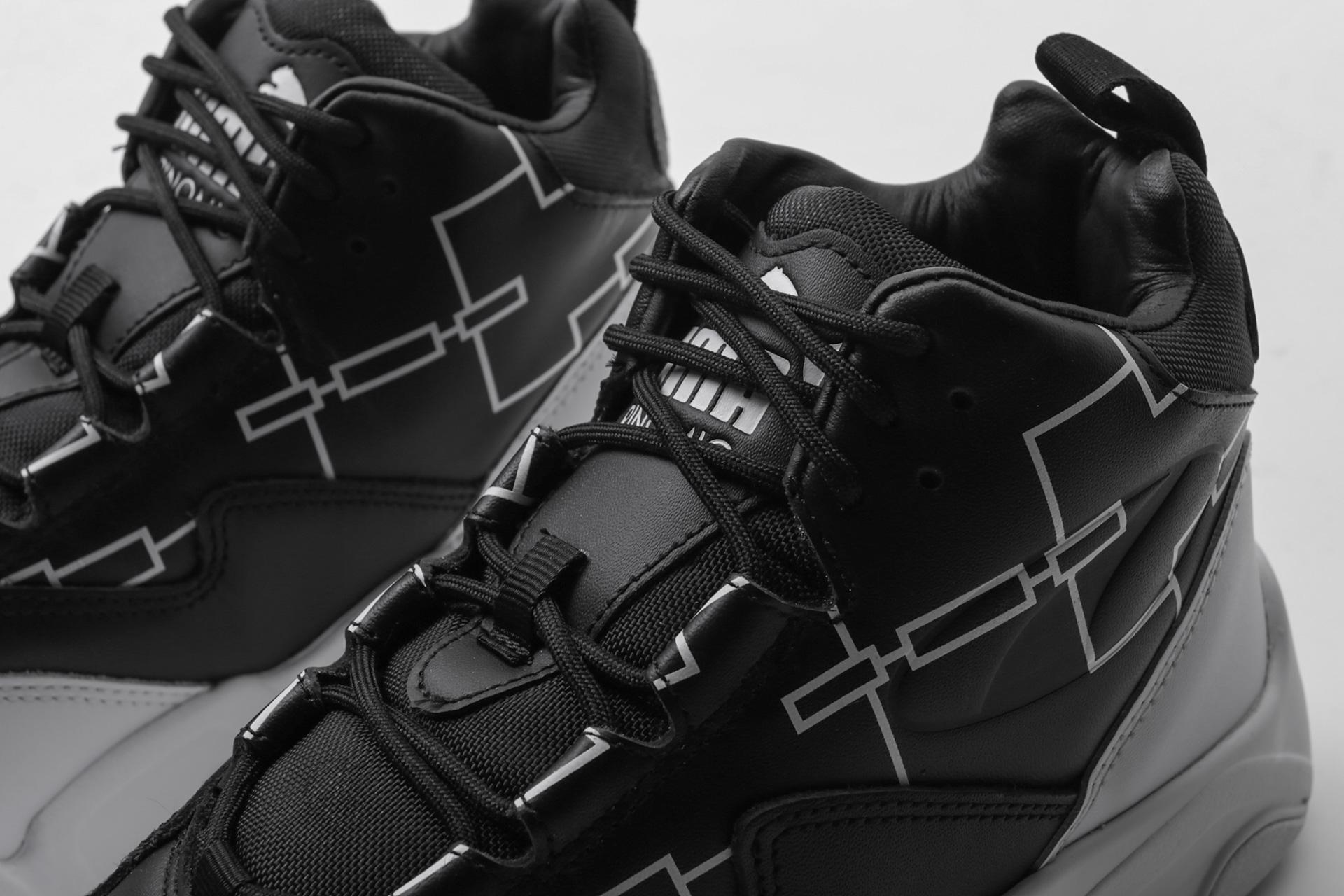 PUMA Sneaker 'Source Mid Bracket' in schwarz weiß